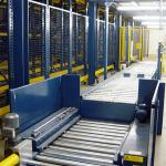 foerdertechnik-palettenundstapelfordertechnik-aufgabestationfureine3geschossigebuhnenanlagemithubstationkonturenkontrolleundwiegeeinrichtung