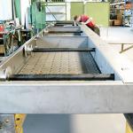 foerdertechnik-sonderforderanlagen-skidfordererfurautomobilchassiesinderlackanlageauchfuraufbauaufhebebuhnegeeignet
